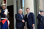 French President Emmanuel Macron shakes hands with Palestinian President Mahmoud Abbas, before their meeting at the Elysee Palace in Paris, on July 5, 2017. Photo by Thaer Ganaim