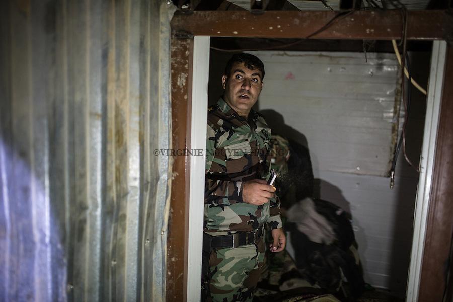 IRAK, Karqasha; A peshmerga fighter is  inside a tunnel build by militant of Daesh in the town of Sheik Amir. This tunnel is 1km long, the 6th December 2016. <br /> <br /> IRAK, Karqasha; Un combattant peshmerga est dans un tunnel construit par des militants de Daesh dans la ville de Sheik Amir, ce tunnel fait 1km de long, le 6 d&eacute;cembre 2016.