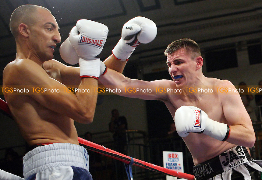 Bradley Skeete (blue shorts) defeats Peter McDonagh for the vacant Southernn Area Welterweight Championship - Boxing at York Hall, Bethnal Green London - 14/09/12 - MANDATORY CREDIT: Rob Newell/TGSPHOTO - Self billing applies where appropriate - 0845 094 6026 - contact@tgsphoto.co.uk - NO UNPAID USE.