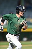 Clinton LumberKings designated hitter Justin Seager (17) runs to first during a game against the Beloit Snappers on August 17, 2014 at Ashford University Field in Clinton, Iowa.  Clinton defeated Beloit 4-3.  (Mike Janes/Four Seam Images)