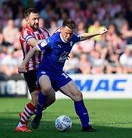 Tranmere Rovers' Connor Jennings under pressure from Lincoln City's Neal Eardley<br /> <br /> Photographer Chris Vaughan/CameraSport<br /> <br /> The EFL Sky Bet League Two - Lincoln City v Tranmere Rovers - Monday 22nd April 2019 - Sincil Bank - Lincoln<br /> <br /> World Copyright © 2019 CameraSport. All rights reserved. 43 Linden Ave. Countesthorpe. Leicester. England. LE8 5PG - Tel: +44 (0) 116 277 4147 - admin@camerasport.com - www.camerasport.com