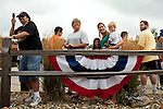 Supporters watch Republican presidential candidate, Rep. Michele Bachmann's bus arrive at a campaign stop in Newton, Iowa, August 5, 2011.