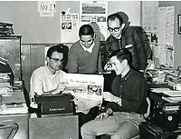 Seated:<br />  Jim Morriss - Managing Editor<br /> Bob Edmeston - reporter, feature writer<br /> Standing:<br /> Jerry Myers, Sports editor and writer<br /> Charles Bickford, photographer<br /> Springdale News Staff 1966