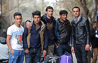 Pictured: Naweed, 18, from Afghanistan (R) with friends and their belongings in Heyden Street, near Victoria Square Tuesday 08 March 2016<br /> Re: Migrants at Victoria Square, in central Athens, Greece.
