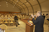 United States Secretary of Defense Donald H. Rumsfeld addresses Korean soldiers in Irbil, Iraq, on October 10, 2004.  Rumsfeld is in Iraq to show support for the coalition troops and meet with Iraqi officials.  <br /> Mandatory Credit: James M. Bowman / DoD via CNP