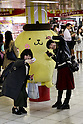 Shinjuku station commuters take a selfie with Sanrio's character Pom Pom Purin or Purin plush dolls displayed along in the Tokyo Metro Promenade on March 8, 2016, Tokyo, Japan. 11 of the huge cuddly characters will be displayed in an underground passage of Shinjuku Station until March 13, as a part of the celebrations for the 20th Birthday of Pom Pom Purin. Sanrio is a Japanese company established in 1963, which has created over 400 cute characters, including the worldwide known Hello Kitty. (Photo by Rodrigo Reyes Marin/AFLO)