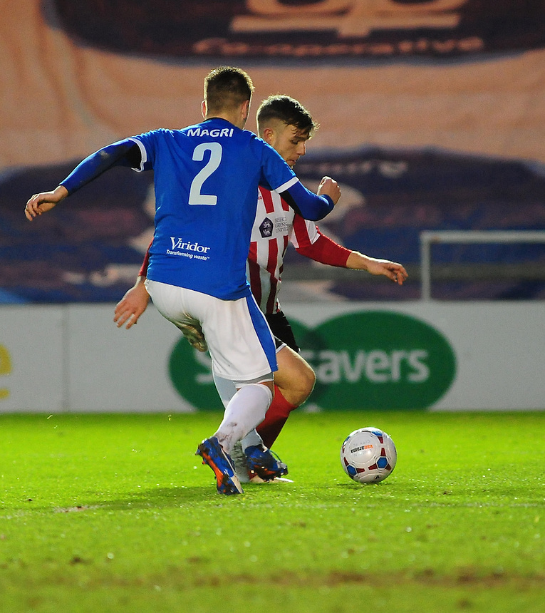Dover Athletic's Sam Magri vies for possession with Lincoln City's Jack Muldoon<br /> <br /> Photographer Andrew Vaughan/CameraSport<br /> <br /> Football - Vanarama National League - Lincoln City v Dover Athletic - Saturday 9th January 2016 - Sincil Bank - Lincoln<br /> <br /> &copy; CameraSport - 43 Linden Ave. Countesthorpe. Leicester. England. LE8 5PG - Tel: +44 (0) 116 277 4147 - admin@camerasport.com - www.camerasport.com