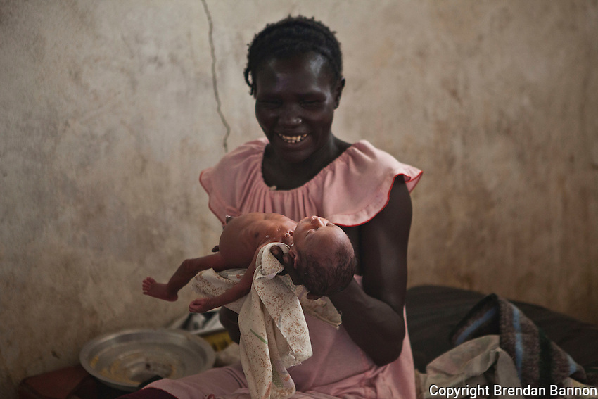 Nyalam and Baby Pim at MSF primary health care center in Nassir, South Sudan. Nyalam delivered Pim, who was 2 months premature, in Nasir PHCC with Dr. Renske Dikkers.  Two of her other sons are here with her, helping her look after Pim...She explains the special relationship she has developed with Renske, the doctor and head of obstetrics in Nasir: ?The doctor comes all the time to check if the baby has complications, like low temperature or high temperature, if the baby did not feed well. She is the one who takes care of them - she even took immediate action when she saw he was in a bad condition?..When he was born, Nyalam didn?t think that her child would survive, as he was so small and wasn?t strong enough to breastfeed. She asked Renske to name him, explaining:  ?I wanted to call my baby with the name of a white person, because this baby was born in the hands of white people. Maybe now Pim will stay alive and not die?. Renske?s first thought was to name the baby after her brother, Pim, whose name could easily be pronounced in South Sudan...Baby Pim was is now gaining weight every day and was transferred to the TFC, as he was stable and needed extra support to gain weight.