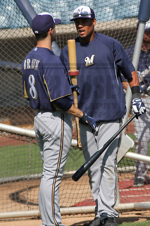 MARYVALE - March 2013: Ryan Braun (8) and Carlos Gomez (27) of the Milwaukee Brewers during a Spring Training practice on March 17, 2013 at Maryvale Baseball Park in Maryvale, Arizona. (Photo by Brad Krause). .