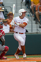 Texas Longhorns first baseman Kacy Clemens (42) follows through on his swing during the NCAA Super Regional baseball game against the Houston Cougars on June 7, 2014 at UFCU Disch–Falk Field in Austin, Texas. The Longhorns are headed to the College World Series after they defeated the Cougars 4-0 in Game 2 of the NCAA Super Regional. (Andrew Woolley/Four Seam Images)