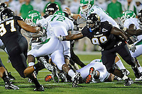 1 September 2011:  FIU defensive tackle Jerrico Lee (98) pursues North Texas running back Lance Dunbar (5) in the first half as the FIU Golden Panthers defeated the University of North Texas, 41-16, at FIU Stadium in Miami, Florida.