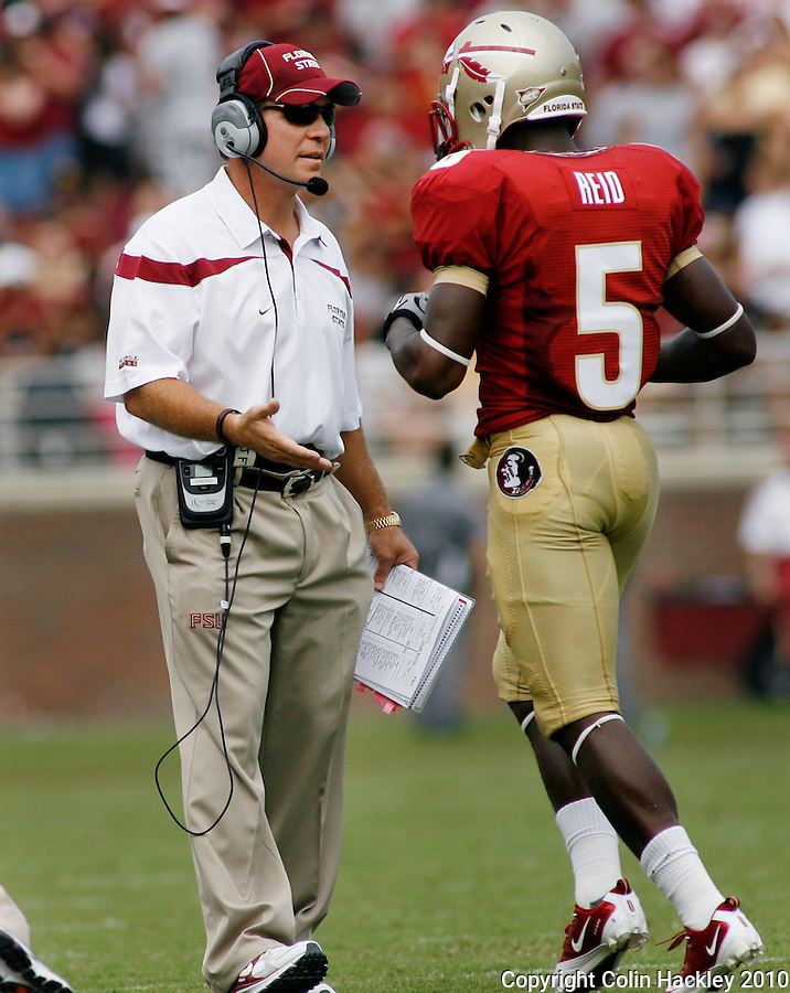 TALLAHASSEE, FL 9/4/10-FSU-SAMFORD FB10 CH-Florida State Head Coach Jimbo Fisher, left, congratulates Greg Reid after his second quarter touchdown against Samford Saturday at Doak Campbell Stadium in Tallahassee. The Seminoles beat the Bulldogs 59-6 to give Head Coach Jimbo Fisher his first victory..COLIN HACKLEY PHOTO