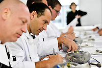Melbourne, 30 May 2017 - The judges prepare to taste the fish dish of Michael Cole of the Georgie Bass Cafe & Cookery in Flinders at the Australian selection trials of the Bocuse d'Or culinary competition held during the Food Service Australia show at the Royal Exhibition Building in Melbourne, Australia. Photo Sydney Low