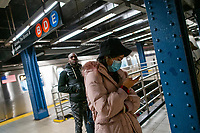 NEW YORK, NEW YORK - MARCH 03 : A woman wears a face mask inside the NYC subway station in New York on March 03, 2020. New York confirms second coronavirus case, as flights cancelations and Jewish schools close over virus fears.The first person to test positive for coronavirus in the state is a 39-year-old health-care worker who arrived from Iran with her husband, the second one is an attorney who lives in Westchester County, works in Manhattan, Gov. Andrew Cuomo said. (Photo by Eduardo Munoz / VIEWpress via Getty Images)