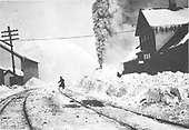 RGS rotary snowplow #2 working north of Durango depot.  Several men watching from depot platform.<br /> Durango, CO  Taken by Bryce, John - or 1916 1911