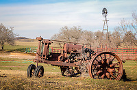 An old tractor sits along old route 66 on the Texas Oklahoma border.