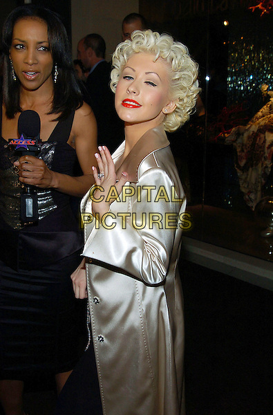 CHRISTINA AGUILERA.Roberto Cavalli unveils his Beverly Hills Boutique on Rodeo Drive with a private party to benefit Race to Erase MS at the Roberto Cavalli Boutique. Beverly Hills, California .February 15th, 2005.half length engagemnet ring brown beige cream silk satin coat jacket.www.capitalpictures.com.sales@capitalpictures.com.© Capital Pictures.