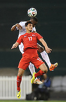 Washington, D.C.- May 29, 2014. Turkey forward Mustafa Pektemek heads the ball against Honduras  defender Victor Bernadez Blanco.  Turkey defeated Honduras 2-0 during an international friendly game at RFK Stadium.