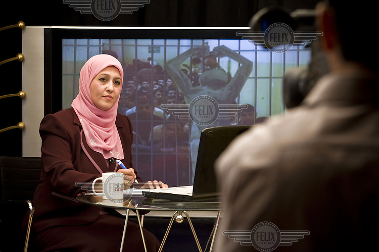 Television presenter Suheir al-Azzawi of Baghdad Channel hosts Patron of the Oppressed. People whose family members are missing call in during the show to seek information.