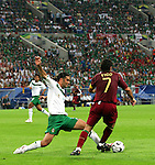 21 June 2006: Rafael Marquez (MEX) (4) stretches to get a toe on the ball against Luis Figo (POR) (7). Portugal defeated Mexico 2-1 at Veltins Arena in Gelsenkirchen, Germany in match 39, a Group D first round game, of the 2006 FIFA World Cup.  With the win, Portugal won the group, but both teams will advance to second round play.
