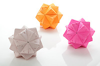New York, NY, USA - November 4, 2011: Three Origami balls each folded from multiple pieces of colored paper by Esme Cribb. The Sonobe module, a folded square of paper used to makes these balls, is a unit used to build modular origami, created by Mitsunobu Sonobe.