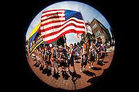 07/04/09 -  Boy Scouts and Cub Scouts stand ready with the American Flag before the start of the annual Fourth of July Celebration and community parade in Birkdale Village in Huntersville, NC, a suburban community north of Charlotte, North Carolina. Birkdale Village combines shopping, dining, apartments and entertainment venues within a 52-acre mixed-use development. Each Independence Day, families gather their children and pets to participate in the popular July 4th community parade. The event includes a firefighter water fight, in which neighboring fire stations blast a large ball (strung on a wire) into the opposing team's area. Charlotte event photographer Patrick Schneider has additional Birkdale Village Fourth of July photos available at http://pa.photoshelter.com/c/patrickschneider/gallery/July-4th-celebrations/G0000CXKFlHTylqk/.