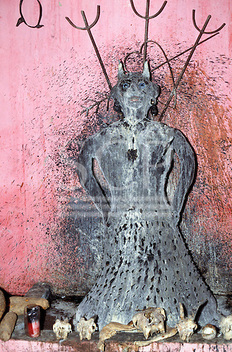 Recife, Pernambuco State, Brazil. Candomble festival: altar for the devil; devil model and bones.