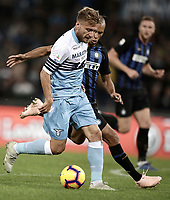 Calcio, Serie A: SS Lazio vs Internazionale Milano, Olympic stadium, Rome, October 29, 2018.<br /> Lazio's Ciro Immobile (l) in action with Inter's Miranda (r) during the Italian Serie A football match between SS Lazio and Inter Milan at Rome's Olympic stadium, on October 29, 2018.<br /> UPDATE IMAGES PRESS/Isabella Bonotto
