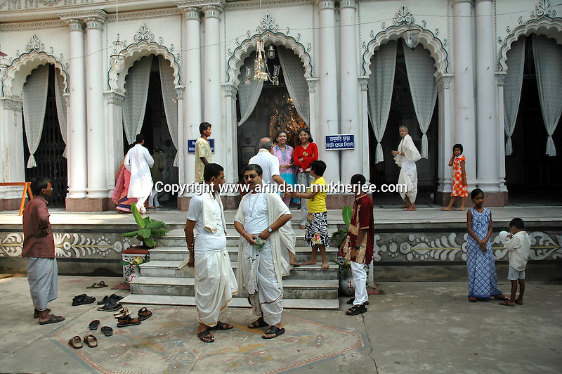 INDIA (West Bengal - Calcutta)  2006,On the ocassion of Durga Puja Festival men family  members in traditional bengali wears at Dev family house. Devs are the most known fudal family during British Period. Durga Puja Festival is the biggest festival among bengalies.  As Calcutta is the capital of West Bengal and cultural hub of  the bengali community Durga puja is held with the maximum pomp and vigour. Ritualistic worship, food, drink, new clothes, visiting friends and relatives places and merryment is a part of it. In this festival the hindus worship a ten handed godess riding on a lion armed wth all possible deadly ancient weapons along with her 4 children (Ganesha - God for sucess, Saraswati - Goddess for arts and education, Laxmi - Goddess of wealth and prosperity, Kartikeya - The god of manly hood and beauty). Durga is symbolised as the women power in Indian Mythology.  In Calcutta people from all the religions enjoy these four days of festival in the moth of October. Now the religious festival has become the biggest cultural extravagenza of Calcutta the cultural capital of India. Artistry and craftsmanship can be seen in different sizes and shapes in form of the idol, the interior decor and as well as the pandals erected on the streets, roads and  parks.- Arindam Mukherjee
