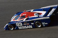 The pole-sitting Nissan GTP ZX-T, entered by Electramotive Engineering and driven by Arie Luyendyk, Chip Robinson, Geoff Brabham and Michael Roe, on the Daytona banking in 1989. Engine problems left the car in 27th place at the finish.