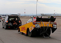 Mar 29, 2014; Las Vegas, NV, USA; The Toyota tow vehicle tows NHRA funny car driver Del Worsham during qualifying for the Summitracing.com Nationals at The Strip at Las Vegas Motor Speedway. Mandatory Credit: Mark J. Rebilas-