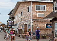 People walk in downtown Ocean Beach on Fire Island in New York state, Wednesday August 3, 2011. The incorporated villages of Ocean Beach and Saltaire within Fire Island National Seashore are car-free during the summer tourist season and permit only pedestrian and bicycle traffic.