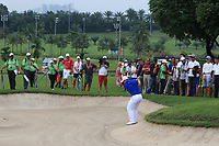 Paul Dunne (Europe) in a bunker on the 18th fairway during the Friday Foursomes of the Eurasia Cup at Glenmarie Golf and Country Club on the 12th January 2018.<br /> Picture:  Thos Caffrey / www.golffile.ie