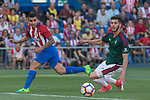 Angel Correa of Atletico de Madrid competes for the ball with David Garcia of Club Atletico Osasuna during the match of La Liga between  Atletico de Madrid and Club Atletico Osasuna at Vicente Calderon  Stadium  in Madrid, Spain. April 15, 2017. (ALTERPHOTOS / Rodrigo Jimenez)