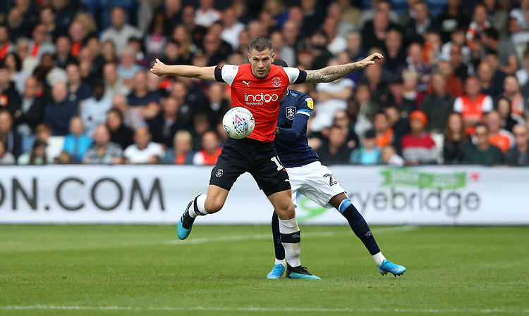 Luton Town's James Collins and Huddersfield Town's Jaden Brown<br /> <br /> Photographer Rob Newell/CameraSport<br /> <br /> The EFL Sky Bet Championship - Luton Town v Huddersfield Town - Saturday 31 August 2019 - Kenilworth Stadium - Luton<br /> <br /> World Copyright © 2019 CameraSport. All rights reserved. 43 Linden Ave. Countesthorpe. Leicester. England. LE8 5PG - Tel: +44 (0) 116 277 4147 - admin@camerasport.com - www.camerasport.com
