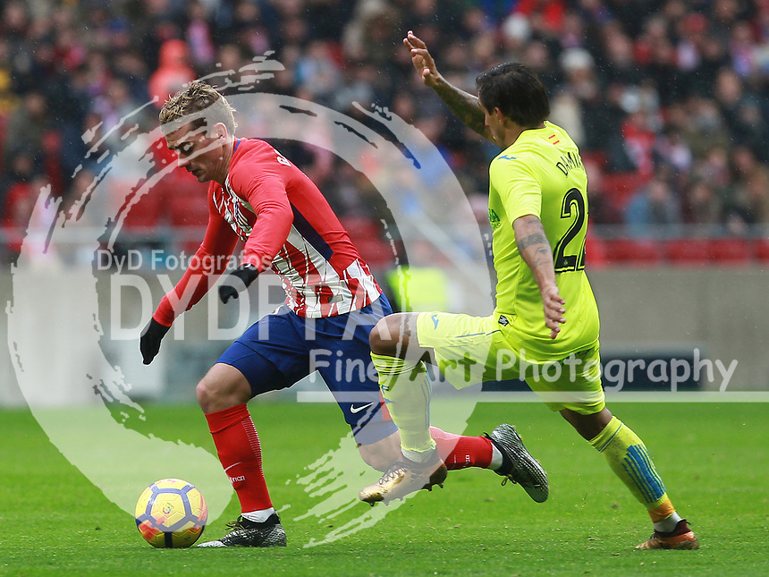 Atletico Madrid's French forward Antoine Griezmann; Getafe's player Damian suarez<br /> <br /> Atletico de Madrid vs Getafe Spanish League football match, La Liga Santander, at Wanda Metropolitano stadium in Madrid on January 6, 2017