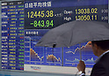 June 6, 2013, Tokyo, Japan - Japanese stock prices plunges into a bear market, ending below 13,000 for the first time in two months on the Tokyo Stock Exchange market on Thursday, June 13, 2013. The benchmark Nikkei dived 843.94 points to 12,445.38 by the close, slicing about 20% off its peak last month above 15,600. (Photo by Natsuki Sakai/AFLO)
