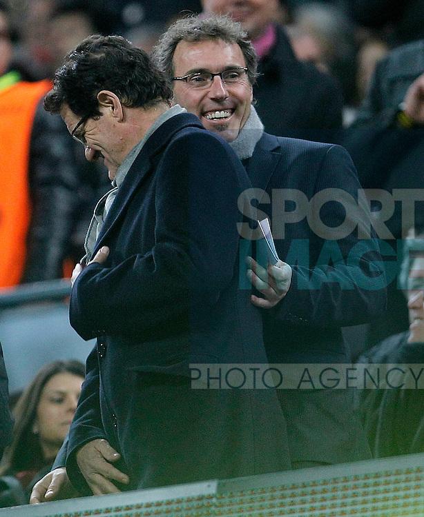 France's coach Laurent Blanc (r) and Endgland's coach fabio Capello during UEFA Champions League match.
