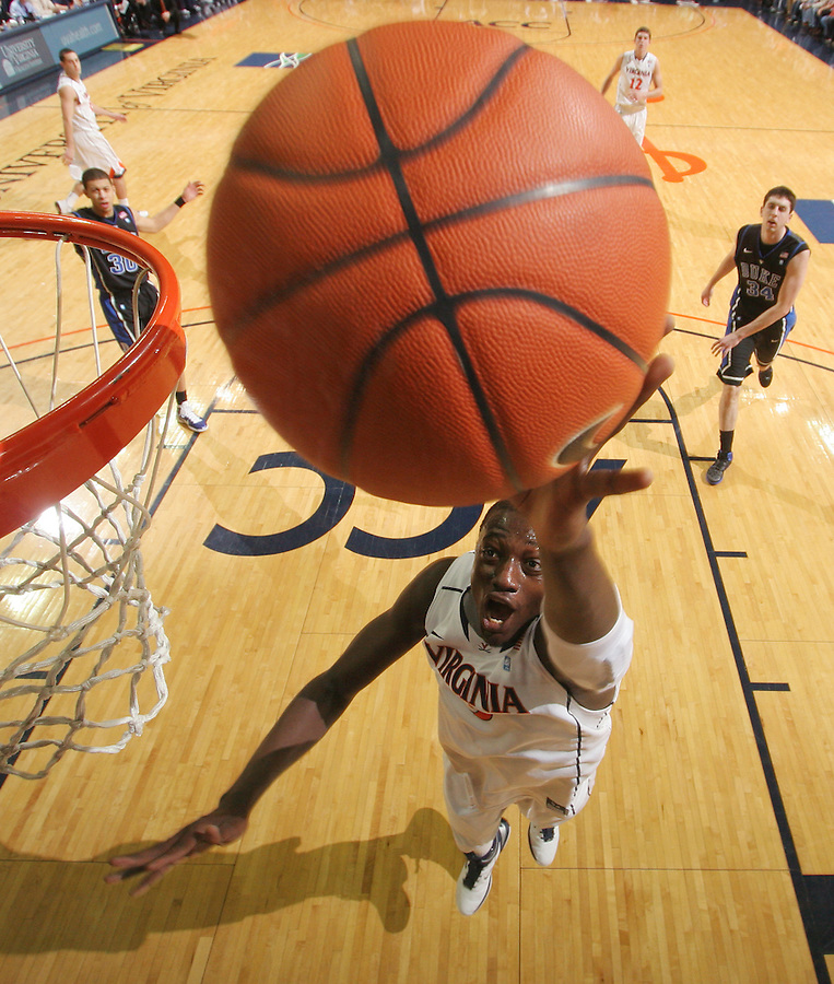 Feb. 16, 2011; Charlottesville, VA, USA; Virginia Cavaliers center Assane Sene (5) shoots the ball during the first half of the game against the Duke Blue Devils at the John Paul Jones Arena. Credit Image: © Andrew Shurtleff