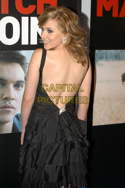 "SCARLETT JOHANSSON.""Match Point"" Premiere at the Embassy Cinema in Rome, Italy.December 20th, 2005.Ref: CAV.half length black dress back behind rear ruffles layers looking over shoulder.www.capitalpictures.com.sales@capitalpictures.com.© Capital Pictures."
