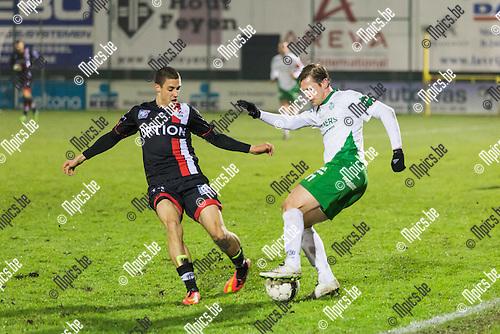 2014-12-06 / Voetbal / Seizoen 2014-2015 / Dessel-OHL / Roy Meeus (Dessel) kapt Alessandro Cerigioni (OHL) uit. <br /> <br /> Foto: Mpics.be