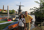 John and Beth with the De Adriaan windmill, Haarlem, Holland, Netherlands.
