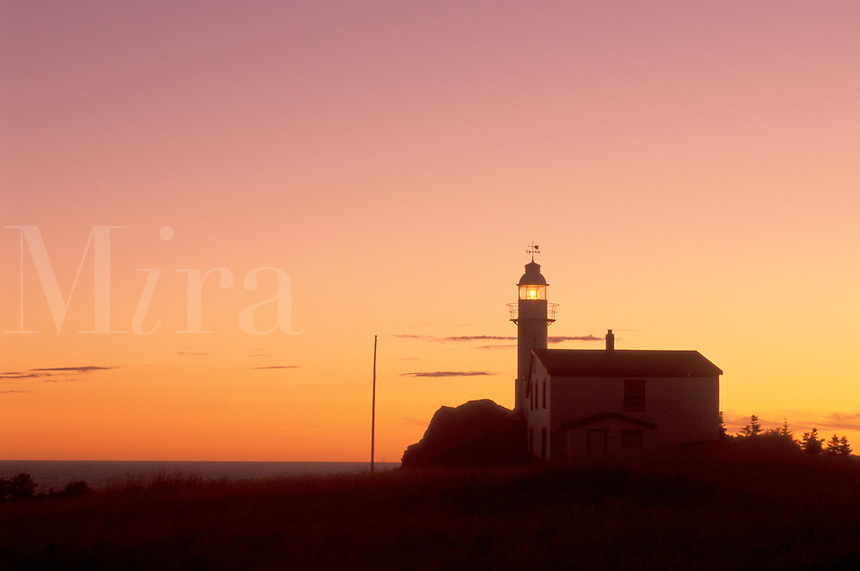 lighthouse, sunrise, sunset, Newfoundland, NF, Canada, Lobster Cove Head Lighthouse on the Gulf of St. Lawrence at sunset. Gros Morne National Park.