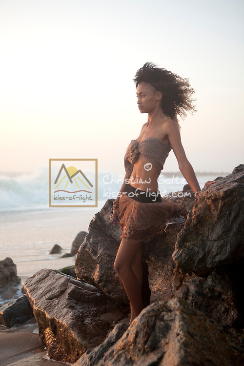 Simona, a young Nama woman, enjoying the sunset at the beach in Swakopmund. She is a modern Namibian citizen and does not know much about the history of her ancestors.