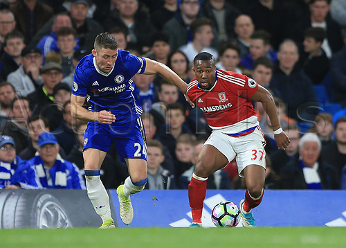 May 8th 2017, Stamford Bridge, Chelsea, London England; EPL Premier League football, Chelsea FC versus Middlesbrough; Gary Cahill of Chelsea and Adama Traore of Middlesbrough both compete for the ball