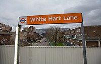 White Hart Lane Station sign with Tottenham Hotspur Stadium in its final stages of completion in the background  at High Road (White Hart Lane), London, England on 19 March 2019. Photo by Andy Rowland.