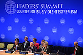 """(L-R, front row) United States President Barack Obama, His Excellency Haider Al-Abadi, Prime Minister of the Republic of Iraq, Her Excellency Erna Solberg, Prime Minister of Norway, (2nd row) Susan Rice, United States Ambassador to the United Nations (behind President Obama), Secretary of State John Kerry and Samantha Power (pink), United States Ambassador to the United Nations, attend the """"Leader's Summit on Countering ISIL and Countering Violent Extremism"""" at the United Nations Headquarters, New York, New York on September 29, 2015. <br /> Credit: Anthony Behar / Pool via CNP"""
