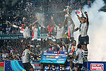 Fiji players celebrate with the trophy on the podium after winning the HSBC Sevens World Cup Final match against New Zealand as part of the Cathay Pacific / HSBC Hong Kong Sevens at the Hong Kong Stadium on 29 March 2015 in Hong Kong, China. Photo by Manuel Bruque / Power Sport Images