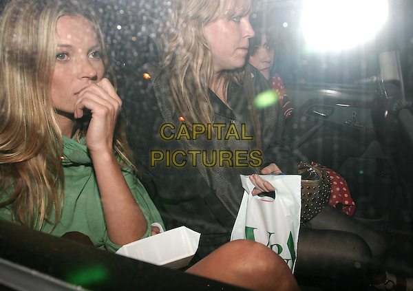 KATE MOSS.Private view to open the V&A's major Westwood exhibition.30 March 2004.car, cab, taxi.www.capitalpictures.com.sales@capitalpictures.com.© Capital Pictures.