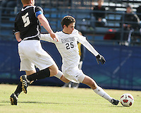 Gabe Padilla #25 of Georgetown University shoots as Bryan Minoque #5 of Providence University moves in during a Big East quarter-final  match at North Kehoe Field, Georgetown University on November 6 2010 in Washington D.C. Providence won 2-1.